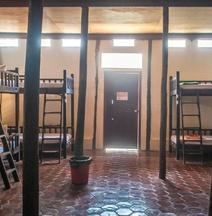 Garden Village Guesthouse & Pool Bar