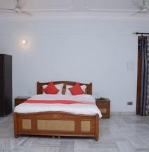 OYO 12180 Surya Prayagam
