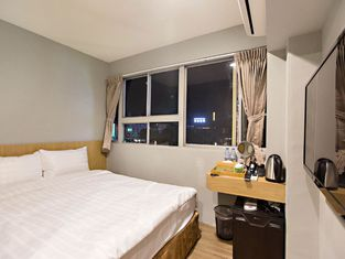 Traveller Inn Tiehua Light Spot Hotel