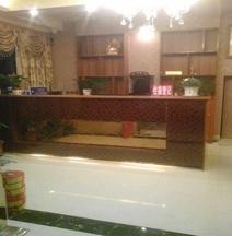 Songzhou Xinyue Business Hotel