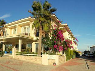 Kamer Suite & Hotel