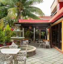 OYO 142 Golden Belle Apartelle and Suites